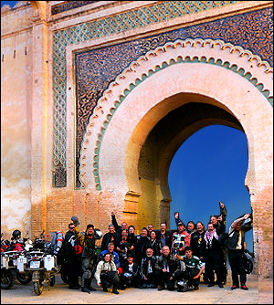 Hispania Tours riders in front of moroccan gate